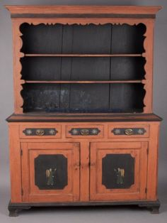 """PENNSYLVANIA PAINT-DECORATED SOFTWOOD DUTCH CUPBOARD, in two sections, top with a cove-molded cornice and applied match-stick frieze above two fixed open shelves, base with applied edge moldings above three lip-molded drawers and two fielded-panel doors, the whole raised on an applied base and ogee bracket feet.  Late 18th/early 19th century. 79 1/2"""" HOA, 37"""" H base, 58"""" WOA.  Good restored condition, cracks to cornice moldings, center drawer with some losses to lip moldings."""
