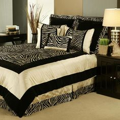 Go wild with your bedroom decor with this zebra print comforter set that features black and taupe colors and soft and velvety fabrics. Set includes comforter, bed skirt, 2 shams, boudoir pillow, and 2 square pillows.