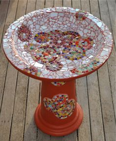 Bright mosaic birdbath. I like that it isn't a symmetrical design, makes for a more casual look.