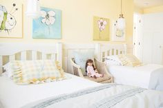 This bedroom was designed for two girls who are 5 years apart. My girls wanted happy color; I wanted a room that could grow as they did. Yellow was the solution. It was bright enough for them; timeless enough for me to mix and match as needed. The art in this room is drawn by my daughter. I took her drawing and recreated oil paintings in colors that matched the decor. She's always been very proud that her art hangs on the wall! Pinned by #TawnaAllred - www.tawnaallred.com