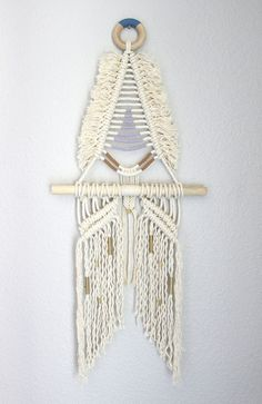 Hand crafted modern macramé wall hanging by May Sterchi of Himo Art. Made of rope, brass and wood with painted elements. One of a Kind. 10.25 inches wide x 23 inches long More with May of Himo Art here.