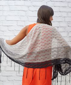 Free Knitting Pattern for Little Waves Shawl - This asymmetric shawl features a seafoam drop stitch pattern in self-striping yarn. Rated easy by the designer. Designed by Christina Danaee for Red Heart