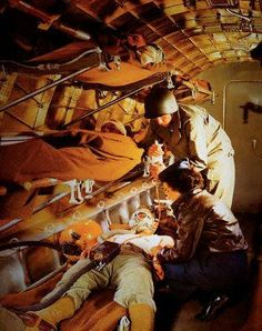 Army nurse working on a stretcher patient while in a transport plane, 12 March 1944 ~ U. Army nurse working on a stretcher patient while in a transport plane, 12 March 1944 ~ Military Photos, Military Art, Women In History, World History, Air Force Nurse, History Of Nursing, Flight Nurse, War Machine, North Africa