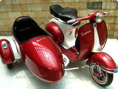 you don't see this on our roads these days - vespa with a side car