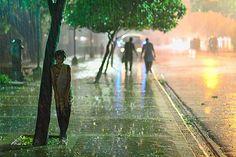 TPOTY Award-winning Travel Photos Street girl in the rain, Dhaka, Bangladesh