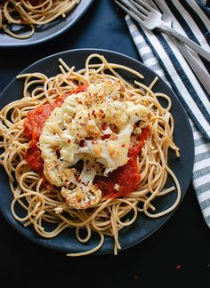 "Parmesan crusted, roasted cauliflower ""steak"" on spaghetti with marinara. This is a super simple, healthy weeknight dinner! cookieandkate.com"