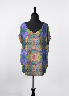 A beautiful and unique essential top that is perfect for your collection! Shop artistic essential top's created by designers all around the world. Green And Orange, Yellow, Night Looks, Signature Design, Fashion Labels, V Neck Tops, Purple, Blue, Skinny Jeans