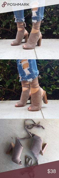"""Taupe open toe mule lace up heels Taupe open toe mule lace up heels   Swoon, we are going crazy for our Enlighten Heel! This open toe heel is a mule silhouette, featuring a lace up detail that wraps around the ankle and ties in the back for a super cute look. The stacked block heel keeps these on trend and in style. We love the soft, faux suede feel of these staples!  Material: Vegan Suede (man-made) Heel Height 4.3""""  Sizes available 5.5-10 in stock Shoes Heels"""