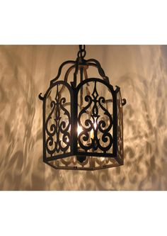 Impress your guests with decadent, wrought iron entry way lighting. The beautiful Alegre Akeria Chandelier can be customized for glass choice and finish. Spanish Style Decor, Spanish Design, Spanish Style Homes, Spanish Colonial, Spanish Revival, Spanish Bungalow, Fachada Colonial, Wrought Iron Chandeliers, Wrought Iron Light Fixtures