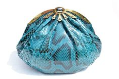 Vintage Skins - 1980's-90's TEAL Blue PYTHON Snake Skin Clutch Shoulder Bag, $345.00 (http://vintageskins.com/1980s-90s-teal-blue-python-snake-skin-clutch-shoulder-bag/)