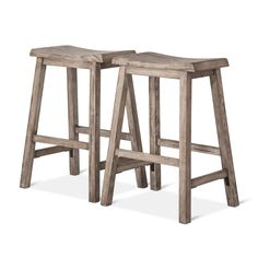 """• Made of sturdy wood<br>• Measures 24"""" high, perfect for lower counters<br>• Includes 2 stools<br><br>Pull up a pair of stools with a weathered wood, farmhouse feel with the Trenton 24"""" Counter Stool in Gray (Set of 2) from Threshold. These stools have a saddle seat and simple lines with footrests."""