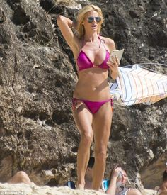 Pretty in pink: Victoria Silvstedt was back on the sand and showcasing her fine form as sh...