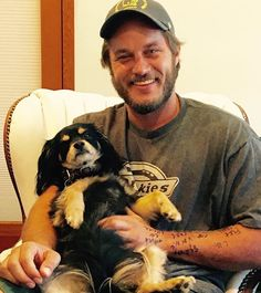Pin for Later: If You Love Charlie Hunnam and Don't Know About Travis Fimmel, You're Missing Out How could anyone resist a guy who snuggles with puppies?