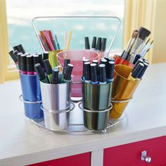 This 1950s aluminum tumbler set with a carrying caddy is a clever and colorful way to store art supplies or make-up. Look for inexpensive secondhand finds at thrift or antiques stores for fun storage solutions.