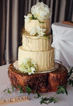 Rustic forest themed wedding cake.  Or did you want cupcakes?  Orchids, peonies and lilies will be in season...