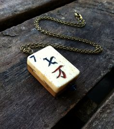 Lucky Number 7 Handmade OOAK Mahjong Game Piece by SSAliceSalvage Lucky 7, Lucky Number, Number 7, Arrow Necklace, Pendant Necklace, Game Pieces, Trending Outfits, Unique Jewelry, Handmade Gifts