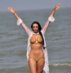 Judi Shekoni in golden lingerie Photos