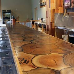 Top 70 Best Rustic Bar Ideas Vintage Home Interior Designs Here we have good wallpaper about wood bar top ideas. We hope these photos can . Epoxy Countertop, Wood Countertops, Pallet Countertop, Wood Bar Top, Wood Stumps, Basement Bar Designs, Into The Woods, Log Furniture, Furniture Design