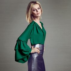 From our exclusive Star by Julien Macdonald collection, this top will add a statement finish to day to evening looks. In a bold green hue, this lightweight piece features a flattering V neckline, concealed placket and tiered ruffled sleeves for added feminine appeal. Keep it simple and team with slim black trousers.