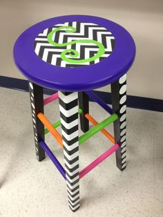After many hours here is how my teacher stool turned out!  Sand, prime, paint. The chevron on the top is just paper with the letter painted on it!  Love it !!!