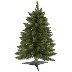 24 inch Battery Operated Pine Artificial Christmas Tree featuring 30 Warm White LED Lights. 6 hour timer uses 3 AA batteries. Indoor use only.