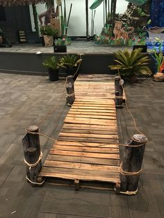 We made a dock out of old pallets. We made a dock out of . - We made a dock out of old pallets. We made a dock out of old pallets. Deco Jungle, Jungle Party, Safari Party, Safari Theme, Jungle Safari, Jungle Theme, Decoration Pirate, Jungle Decorations, Halloween Decorations