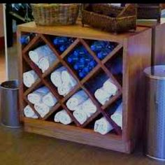 workout room towel & water bottle storage - I don't have a workout room but I have wondered where I could store water bottles and if there was something that could be done with wine racks besides store wine (which we don't drink). Cool idea.