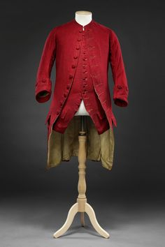 Formal coat and waistcoat, 1760s. Purple red figured wool, silk lining, buttons finely worked with star motifs in two shades of thread.
