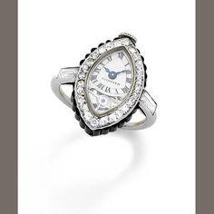 "Bonhams 1793 : A rare art deco onyx and diamond ""Montre Bague Navette"" keyless ring watch, by Cartier,"