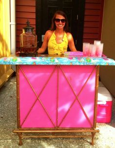 this looks awesome....she added some paint and contact paper to a cheap outdoor bar and created something beautiful.