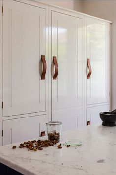 Leather handles are a smart, modern update for classic cabinetry. Beautiful Kitchens loves this design by British Standard.
