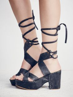 Illusion Covered Platform | Vintage-inspired leather platforms featuring crisscross strap detailing and adjustable lace-up ties. Chunky block heels and exposed seaming. Rounded toe.