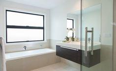A wall hanging vanity makes this bathroom look sophisticated. House, Vanity Units, Home, Vanity, Modern, Corner Bathtub, Bathroom, Interior Design, Bathtub