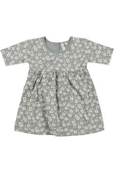 This pretty dusty blue dress is printed all over with winter florals. Made of a soft jersey by Rylee and Cru, it is perfect for winter holidays or for everyday wear. Available in infant sizes up to toddler size 2.