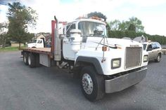 1994 Mack Tandem RD688s Steel Flatbed Location: Great Meadows, NJ 07838 Price: $17,000.00 Year: 1994 Make: Mack Model: RD688S 21ft Steel Flatbed Vin #: 1M2P267C5RM020435 Miles: TMU Engine: E7 Mack 350hp Transmission: 8LL Eaton Fuller Tandem Axle GVW 57,540 Tare Weight 22,460lbs Jake Brake A/C Rear Forklift Mount Used Heavy Trucks? Buy IT or Sell IT. IT STAYS LISTED-UNTIL IT SELLS IRONMARTONLINE.com Dumps . Tractors . Antique Call Today and Let's get IT SOLD! 973-886-3020 Mack Dump Truck, Dump Trucks, Heavy Equipment For Sale, Eaton Fuller, Heavy Construction Equipment, Heavy Truck, Trucks For Sale, Tandem, Tractors