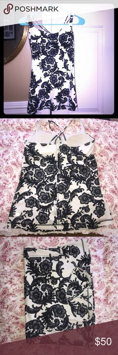 Lululemon size 8 tank top Black Lace Print Gorgeous size 8 Lululemon Lace print workout top in excellent condition. Includes cup inserts lululemon athletica Tops Tank Tops