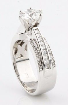 18k White Gold Round Brilliant Diamond Engagement Ring With Princess Cut Stones #SolitairewithAccents