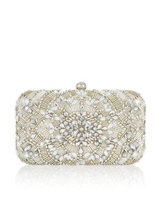 Go all-out with embellishment courtesy of our Charlotte hard case clutch bag. Adorned with gold-tone beads and dazzling crystal gems, this beautiful accessor...