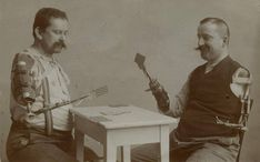 Soliders plaiyng cards, with their new prosthetic limbs - during WWI, 1914- 1918.