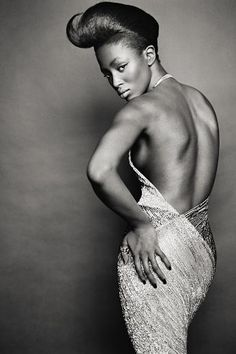 Supermodel Naomi Campbell brings the bouffant beehive hair in a bootylicious gown by photographer Mario Testino. She is #TheFace.