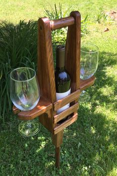 Pointed stake sticks into the ground and securely holds a bottle of wine and two wine glasses. The main portion of this piece is made from cedar and should last for a very long time. The stake and post on the bottom is pine and the whole piece is finished with stain and polyurethane.