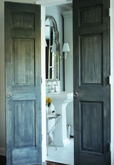 i want doors like this!  love the look of the washed up wood and the rings instead of knobs.  beautifully done