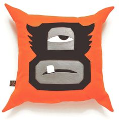 """El Monsturo 'Cushionface' Orange Felt Cushion. £23     Handmade. With zip at bottom and removable cushion pad.    Signed and numbered by Dr. Zung of Streets of Beige    14"""" x 14""""    Limited edition of 5 pieces"""