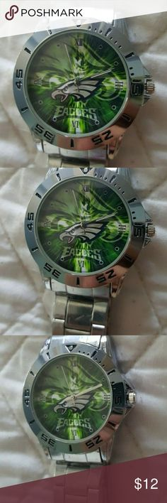 Philadelphia Eagles Logo Stainless Steel Watch NEW Philadelphia Eagles NFL Logo Stainless Steel Watch NEW  High Quality Quartz Movement: provide precise and accurate time keeping.  Case Diameter :4.10 Centimeter ;Band Width : 1.90 Centimeter.  Double Locking Fold Over Clasp.  Waterproof For Daily Use: Perfect for all kind of business, casual, indoor activities or daily use. NOTE:In general, withstands splashes or brief immersion in water, but not suitable for swimming. NFL Accessories Watches