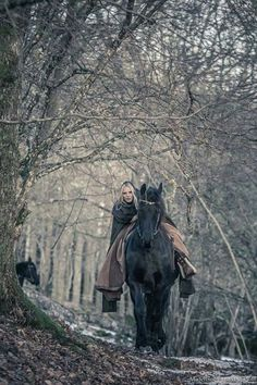 Horse back riding in the winter forest.