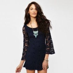 NEW 70s Style Midnight Blue Lace Dress Lace dress in a swingy 70s style. Midnight blue color, it's darker than the fourth picture. Reaches about mid-thigh. New, never worn.  ***Looking to sell ASAP so make an offer!*** Nasty Gal Dresses