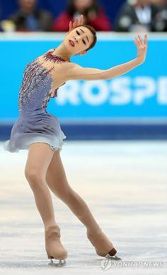 Kim Yu-na of South Korea skates during the short program at the World Figure Skating Championships in London, Ontario,