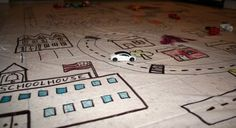 Make your own play mat for the kids to drive cars on and decorate themselves - great busy bag idea!
