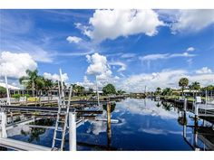 PUNTA GORDA SEASONAL SHORT TERM  RENTED TILL APRIL 15, 2017.  Walking distance to the Fisherman's Village and Isles Yacht Club! Spectacular water view with 82 foot concrete seawall, dock and 14,000 lbs boat lift... This 3 bedroom, 2 bath, PLUS SEPARATE OFFICE (with built-in cabinetry) offers 18-inch porcelain tile, and wood flooring throughout the entire house, with no carpeting. Completely remodeled gourmet kitchen with solid wood cabine...