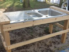 I bought some sinks off eBay and our caretaker made the stands for them. Now we have a sand kitchen...we've added some pots and pans. The children write menus and recipes.